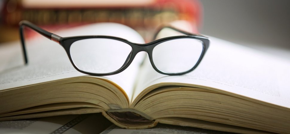 book with glasses by Inc.